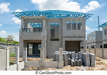 New home under construction using steel frames against...