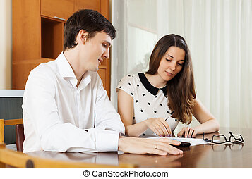 young family with financial documents at home