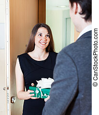Pretty woman giving gift to man