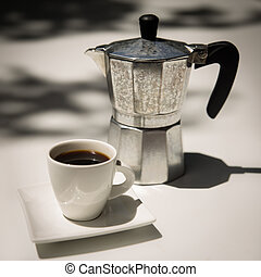 Coffee and Stovetop Espresso - A cup of coffee and stovetop...