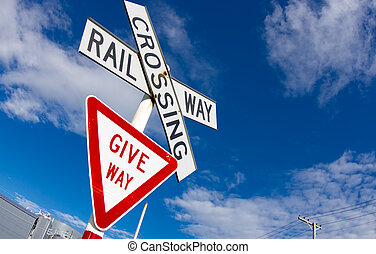 Give Way Sign - A railroad crossing and Give Way sign...