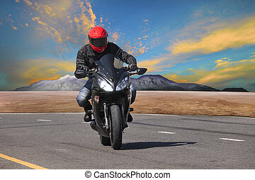 young man riding motorcycle in asphalt road curve use for...