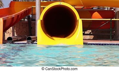 Senior Have Fun On Water Slide in water park