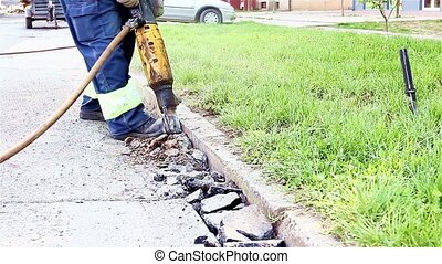 Road Repairing Works with Jackhamme - Construction worker is...