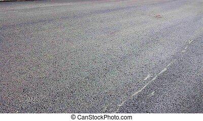 Steamroller flattens asphalt