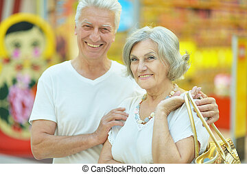 Senior couple - Beautiful senior couple in a shopping center