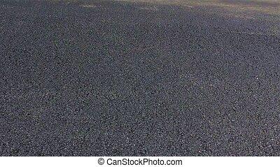 Steamroller flattens asphalt - Steamroller smoothing hot...