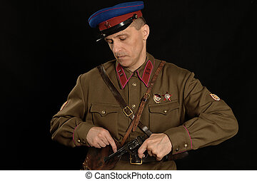 colonel commander with a gun on a dark background