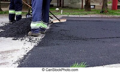 Road Construction - Road construction worker leveling...