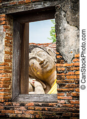 Asian religious art. Ancient sandstone sculpture of Buddha...