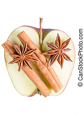 anise and cinnamon on a juicy apple