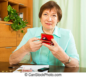 Woman looking concerned counting of money