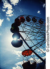 ferris wheel - Big ferris wheel silhouette against the blue...