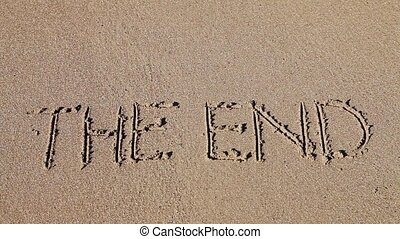 The end drawn in the sand - Word the end deleting ocean...