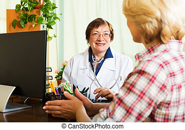 Aged doctor having good news for a patient