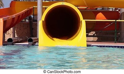 Children have fun in water park - Children sliding on water...