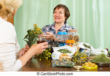 woman drinking herbal tea with her friend