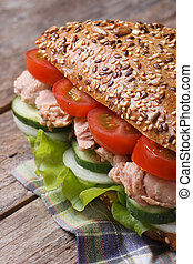 tuna sandwich with lettuce, tomatoes, cucumbers and onions