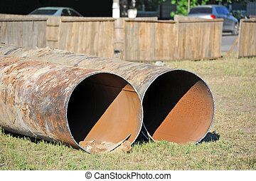 Steel pipe - Large rusty steel pipe on construction site