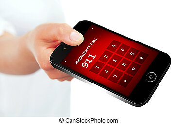 hand holding mobile phone with emergency number 911 focus on...