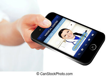hand holding mobile phone with medical center website focus...