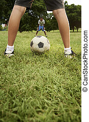 Kids playing football and soccer game in park - Children...