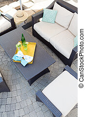 Upmarket outdoor patio with garden furniture - View from...