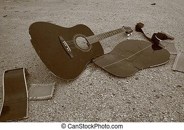 broken guitar, laying on the floor