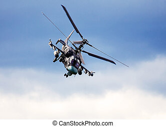 Combat helicopter in flight - Flight ofy the modern russian...