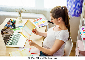 Pregnant woman working from home - Pregnant woman in home...
