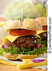 American cuisine - Juicy beef burger with cheese and French...