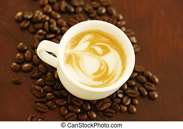 Top view of piccolo latte with a coffee art design. - Top...