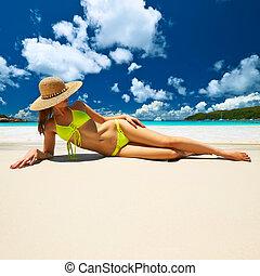 Woman at beach - Woman in bikini at tropical beach at...
