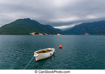 Perast, Montenegro. - lonely boat in the bay. Perast,...