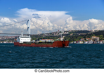 Bosporus, Turkey - Cargo vessel and Istanbul Bosporus,...