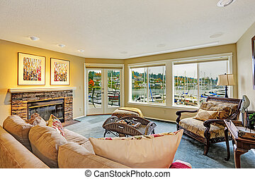 Living room with water front view