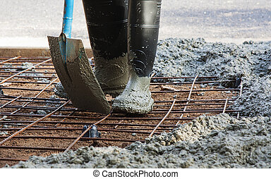 concreting - person with gum boots on working in spreading...