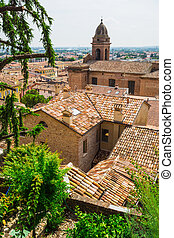 andscape with roofs of houses in small tuscan town in...