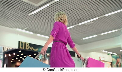Shopping Therapy - Slow motion of buyer with shopping bags...