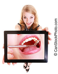 Girl showing ipad tablet touchpad with dental photo of teeth...