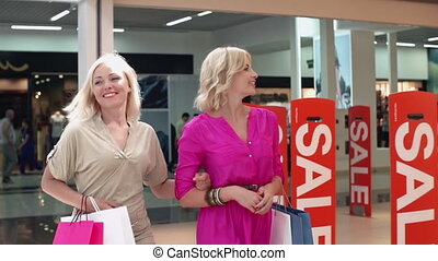 Cream of the Crop - Slow motion of two girl friends shopping