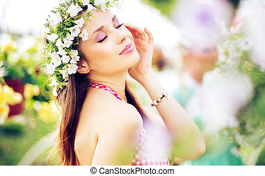 Pretty brunette lady with the colorful wreath on the head
