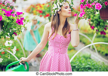 Pretty lady smelling the flowers - Pretty lady smelling the...