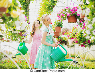 Two rustic girls in the green house