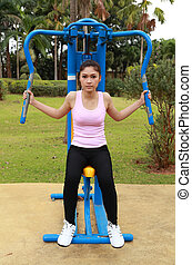 woman exercising with exercise equipment in the park