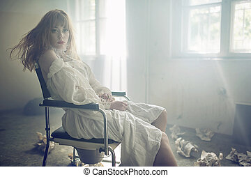 Portrait of the young pale woman in the old hospital -...