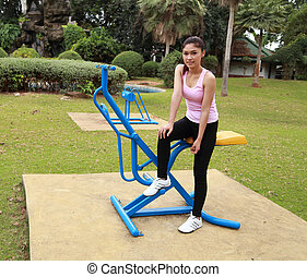 woman with exercise equipment in the park