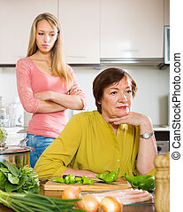 mature mother against adult daughter after conflict