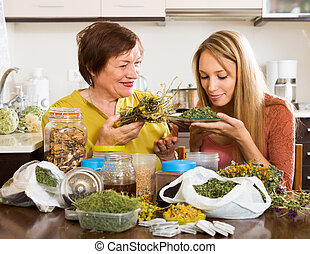 Womans with medicinal herbs - Happy womans with medicinal...