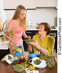 Mother and daughter with herbal tea - Smiling mother and...
